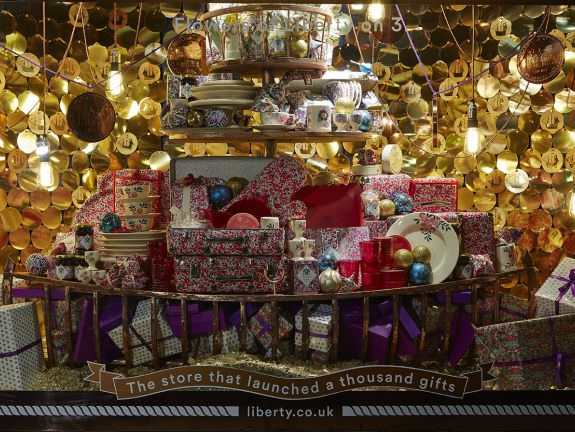 Christmas window display featuring thousands of laser cut paper baubles for Liberty of London